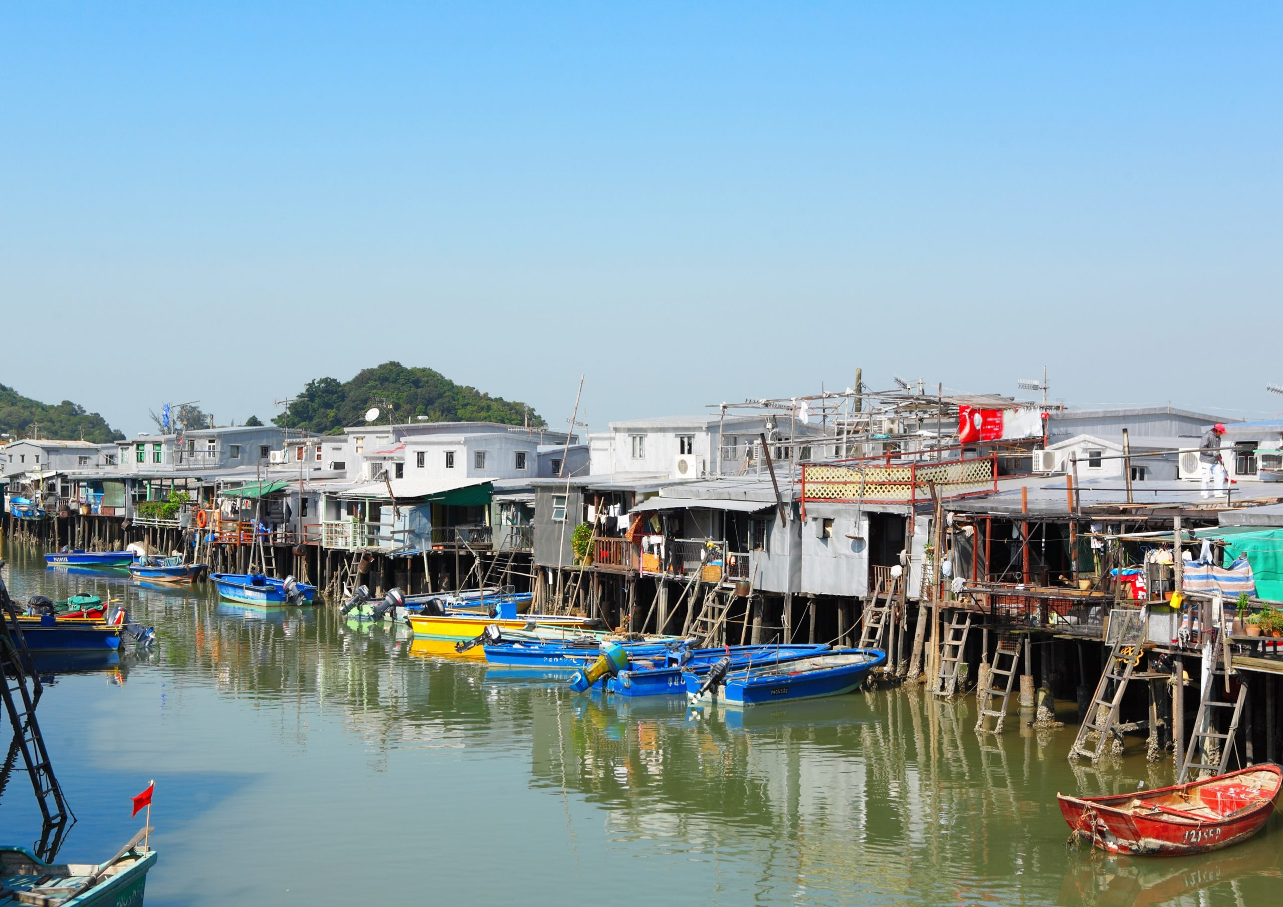 Spend your day and soak in the village's idyllic life, admire the traditional stilt-houses, and savour local treats